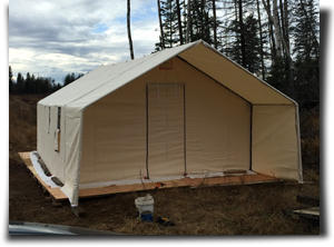 Capital Canvas customer Ryan Muyres with 14x16 canvas wall tent and porch on his wood platform.